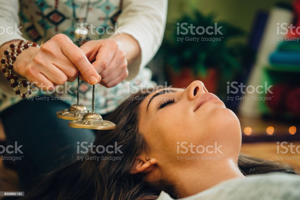 Tibetan bells in sound therapy stock photo