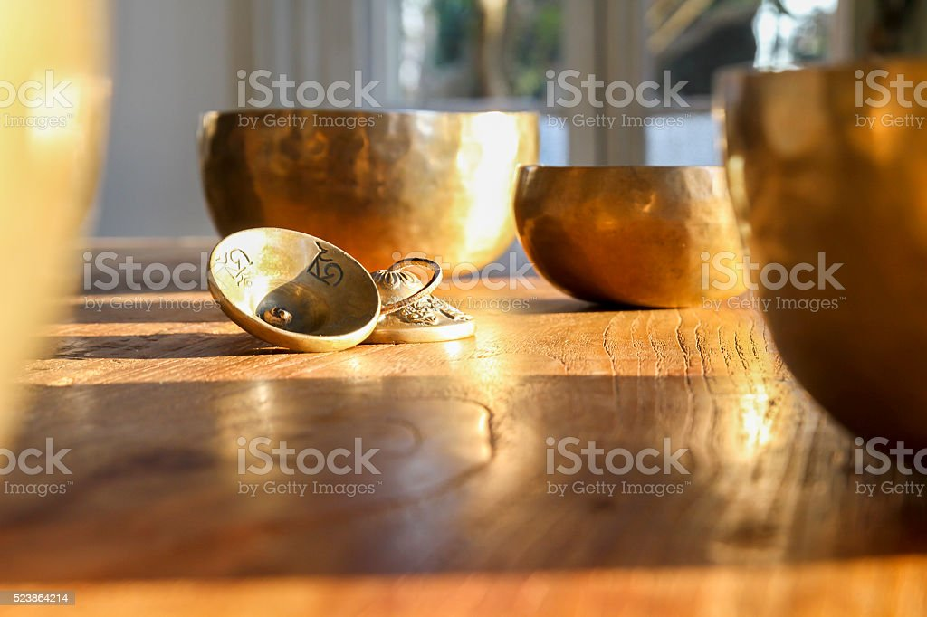Tibetan bells on a wooden table stock photo