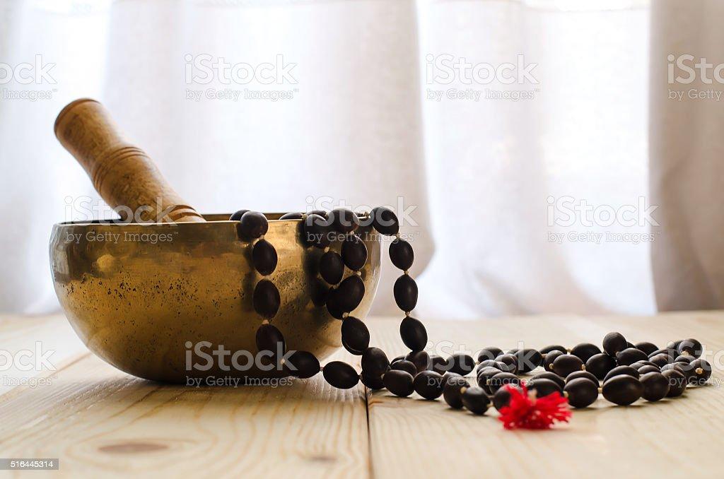 Tibetan bowl  and  mala beads stock photo