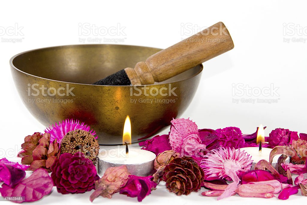 Tibetan bowl, flowers and candles. stock photo
