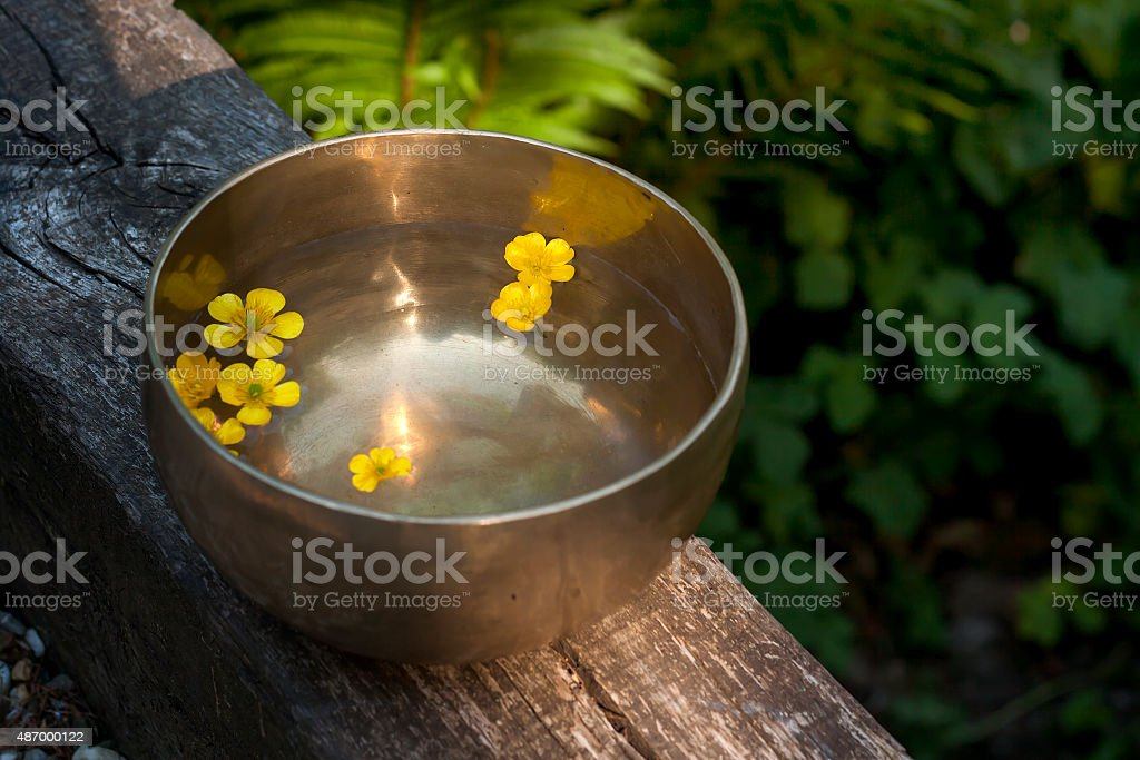 tibetan bowl with yellow flowers stock photo