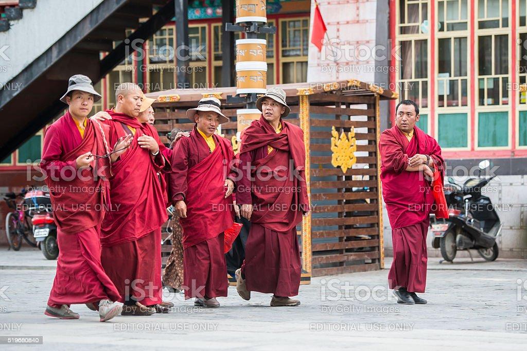 Tibetan buddhist monks at the Barkhor in Lhasa, Tibet. stock photo
