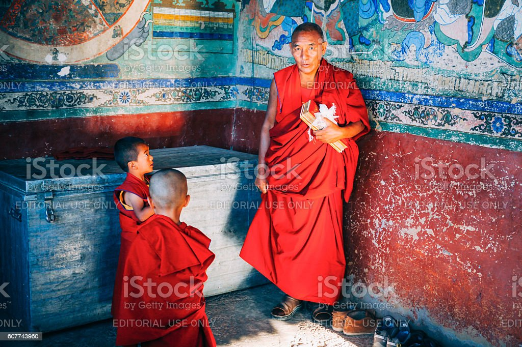 Tibetan Buddhist Monks prepared for chanting in Thikse Monastery stock photo