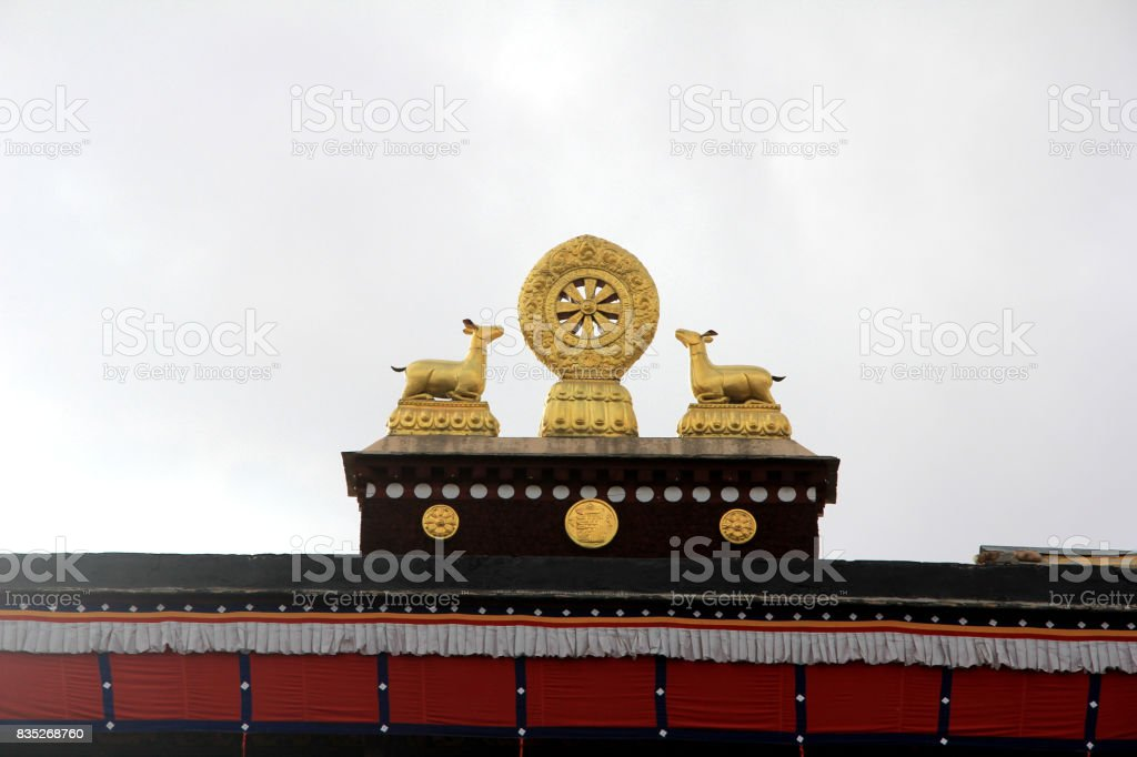 Tibetan Carve on the roof, a deer shaped golden beast and Falun(Dhammacakka) stock photo