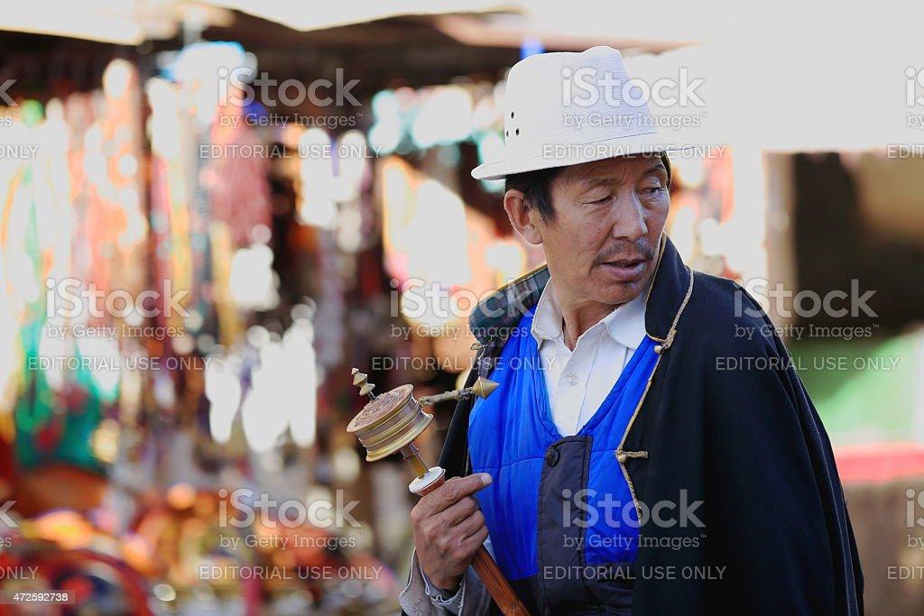 Tibetan devotee does the Kora-circumambulation. Lhasa-Tibet. 1332 stock photo