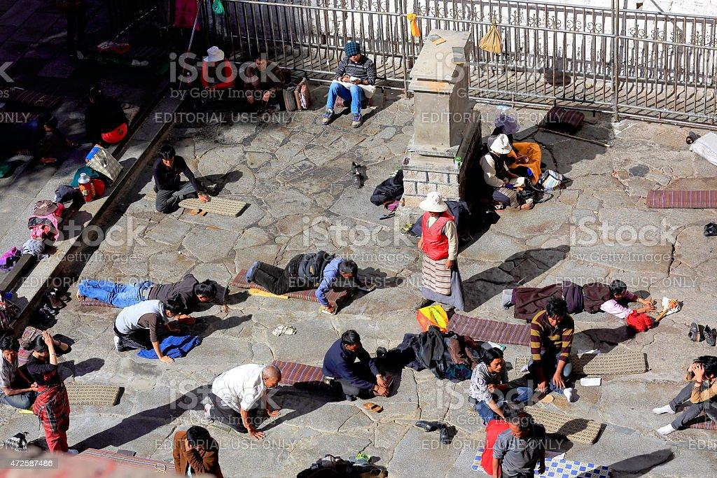 Tibetan devotees at pray and prostrate. Jokhang-Lhasa-Tibet. 1432 stock photo