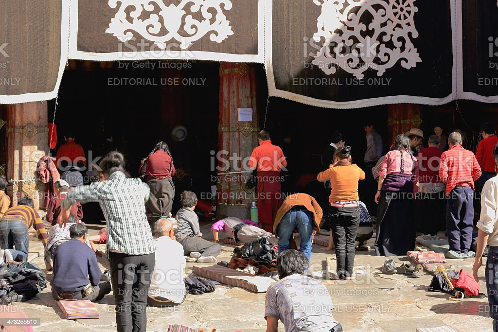 Tibetan devotees praying and prostrating. Jokhang-Lhasa-Tibet. 1437 stock photo