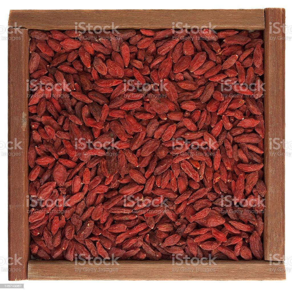 Tibetan goji berries (wolfberry) in wooden box royalty-free stock photo