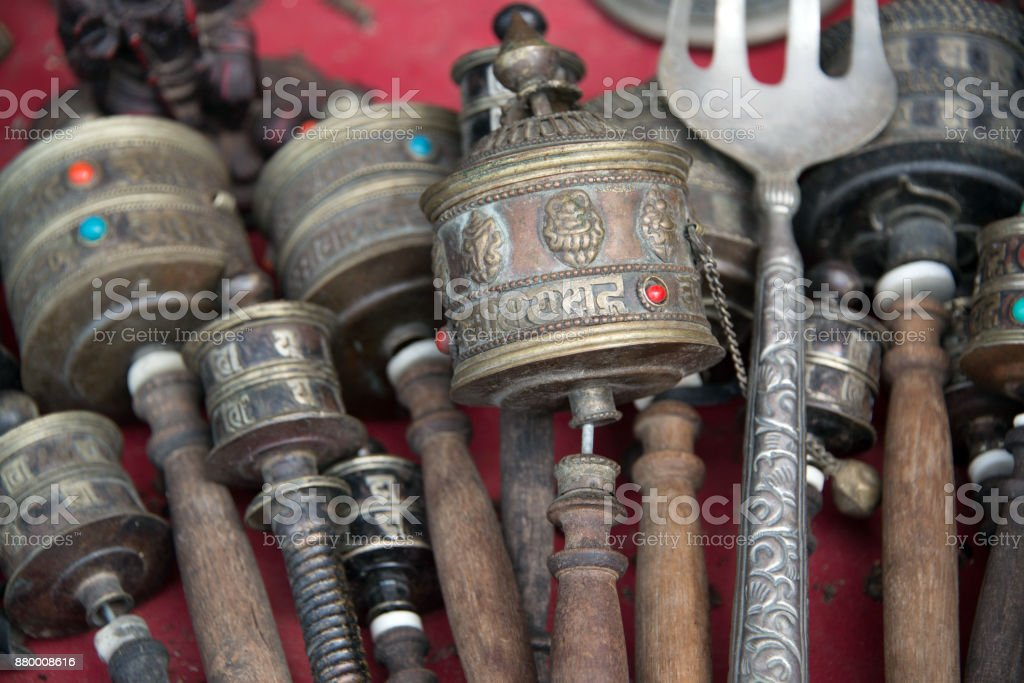Tibetan Hand prayer wheels cylindrical with wooden handles assorted styles and sizes on a table stock photo