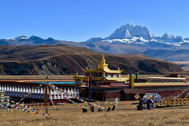 Tibetan holy mountain Mt. Yala with its summit at 5820m and Tagong temple, Sichuan, China. People are really religious in this area. yala stock pictures, royalty-free photos & images