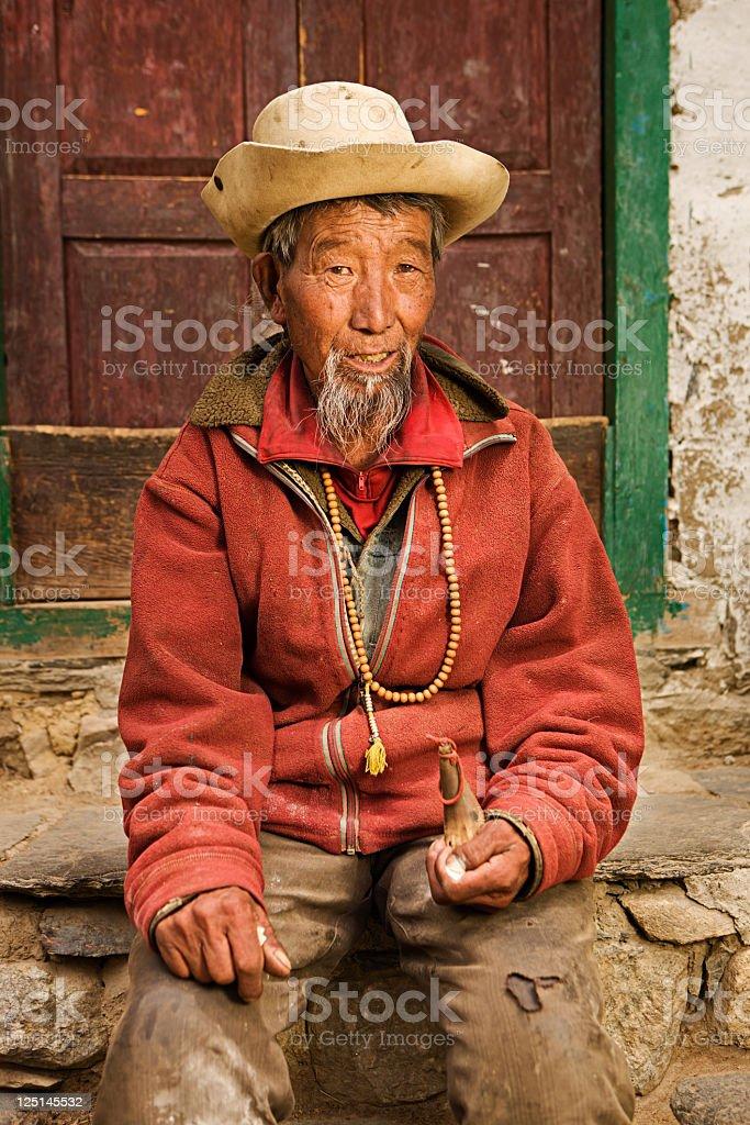Tibetan man with rosary, Mustang, Nepal royalty-free stock photo