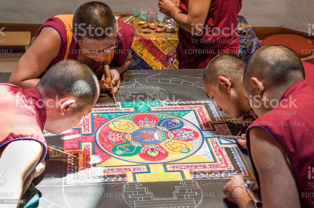 Tibetan monks making a mandala stock photo