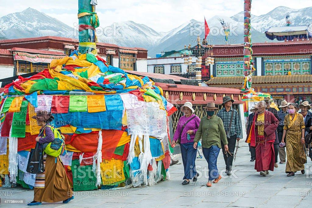 Tibetan pilgrims at the Barkhor in Lhasa, Tibet. stock photo