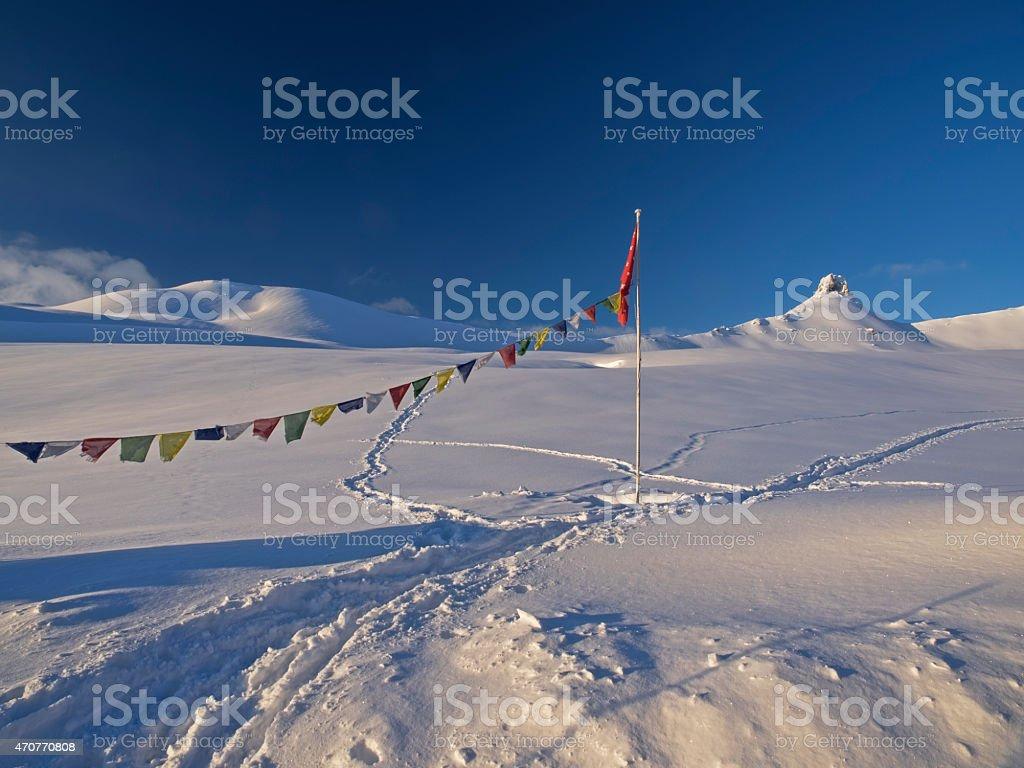 Tibetan prayer flags and Mount Spitzmeilen stock photo