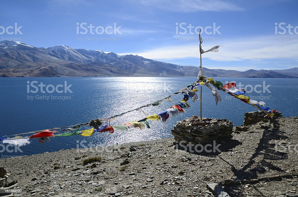 Tibetan prayer flags at lake stock photo