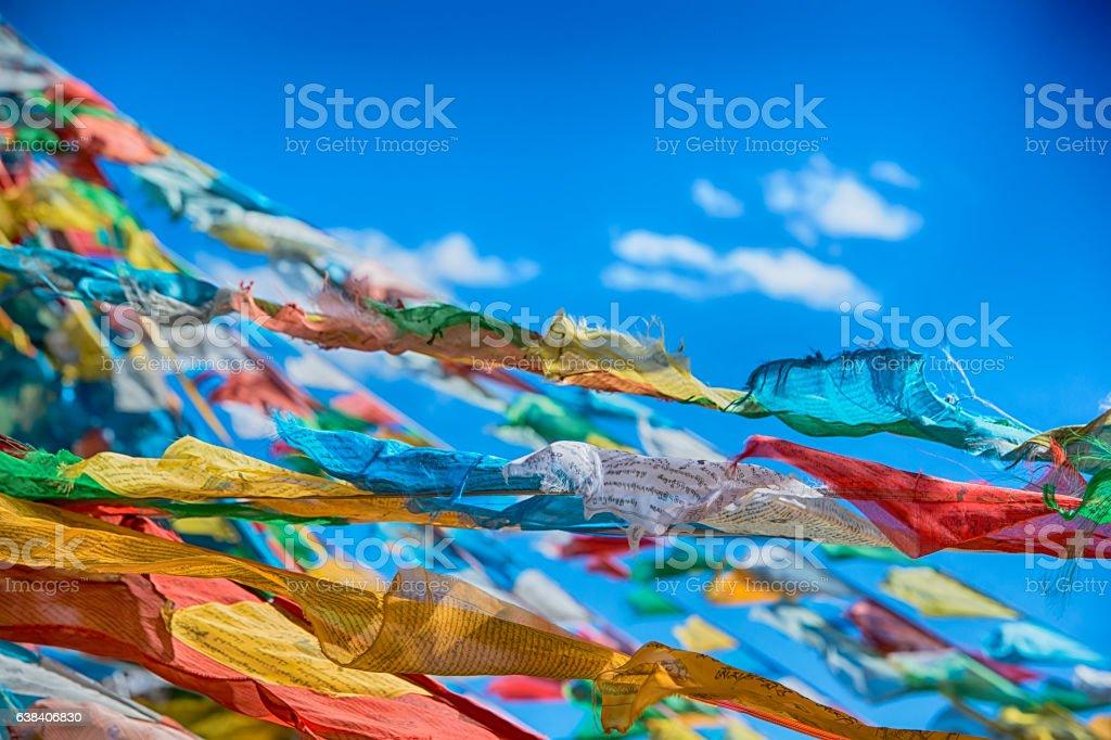 Tibetan prayer flags on a mountain pass in Tibet stock photo