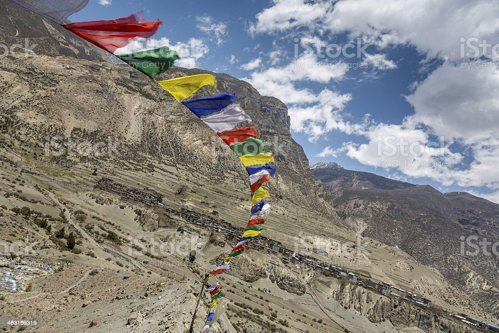 Tibetan Prayer Flags with City of Manang Behind, Nepal royalty-free stock photo