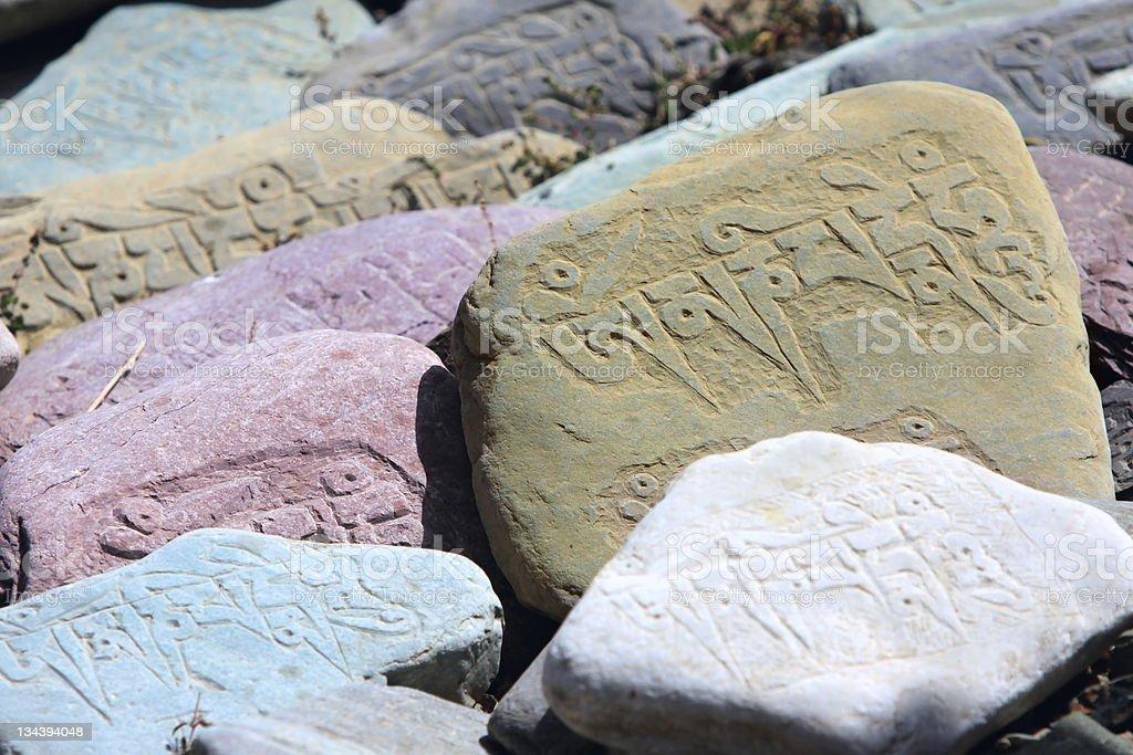 Tibetan prayer stones royalty-free stock photo