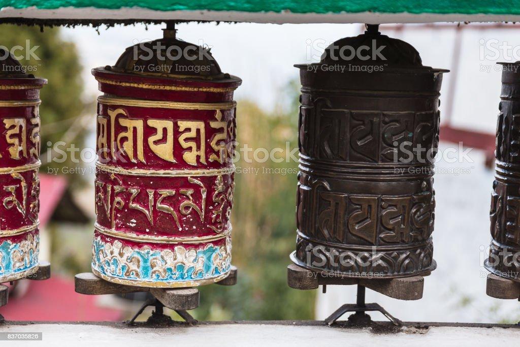 Tibetan prayer wheel in area of Rumtek Monastery in winter near Gangtok. Sikkim, India. stock photo