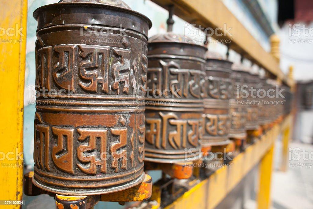 Tibetan prayer wheels or prayers rolls of the faithful Buddhists stock photo
