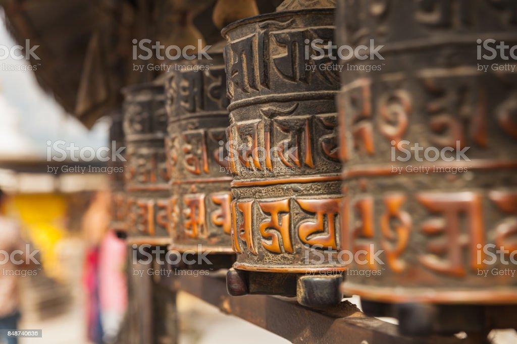 Tibetan prayer wheels or prayer's rolls of the faithful Buddhists. stock photo