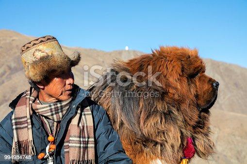 Shepherd with his Tibetan Mastiff Dog