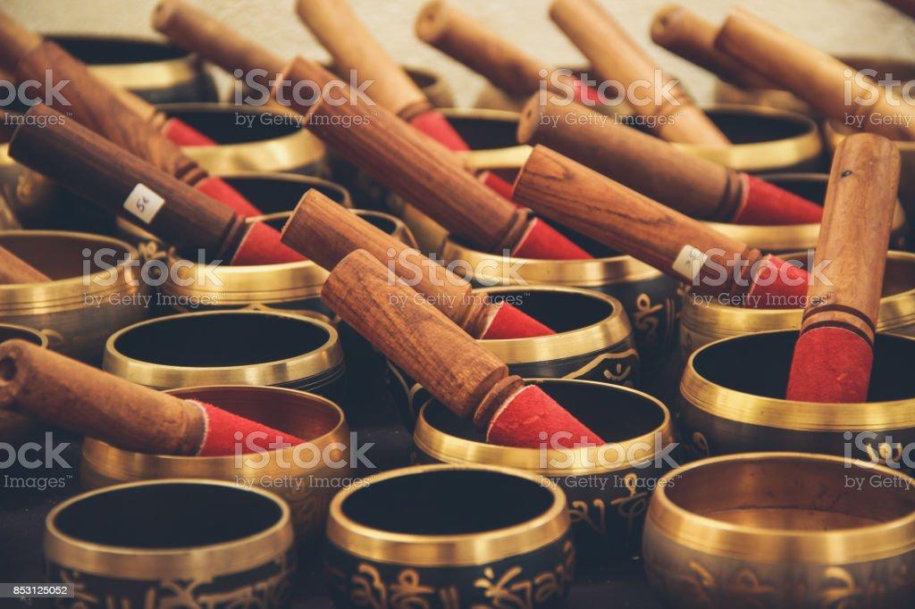 Tibetan singing bowl in a street market stock photo
