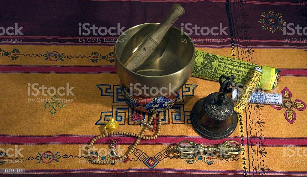 Tibetan Singing Bowl  prayer beads bell and dorje stock photo