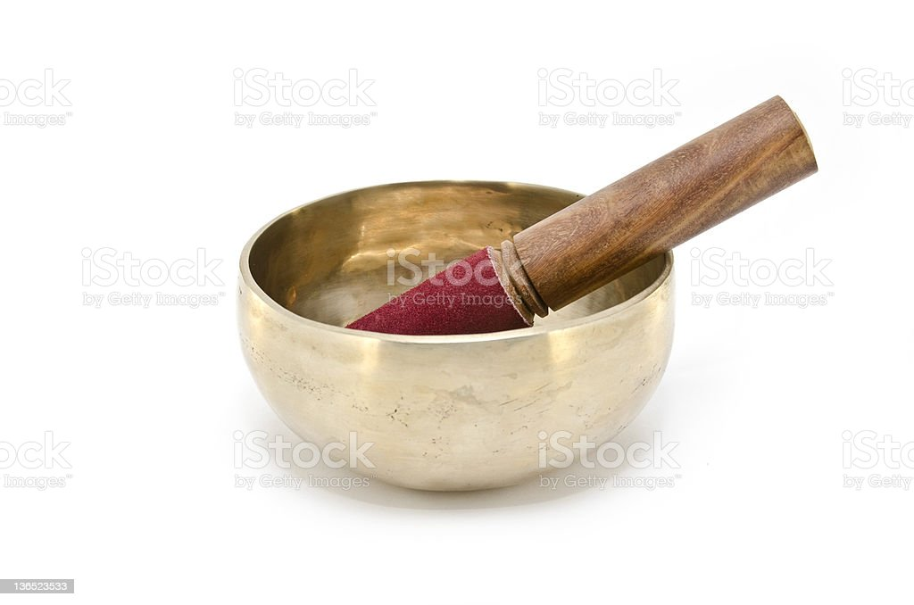 Tibetan singing bowl used in meditation on white background royalty-free stock photo
