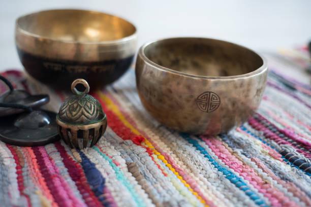 Tibetan singing bowls and tibetan bell for meditation stock photo