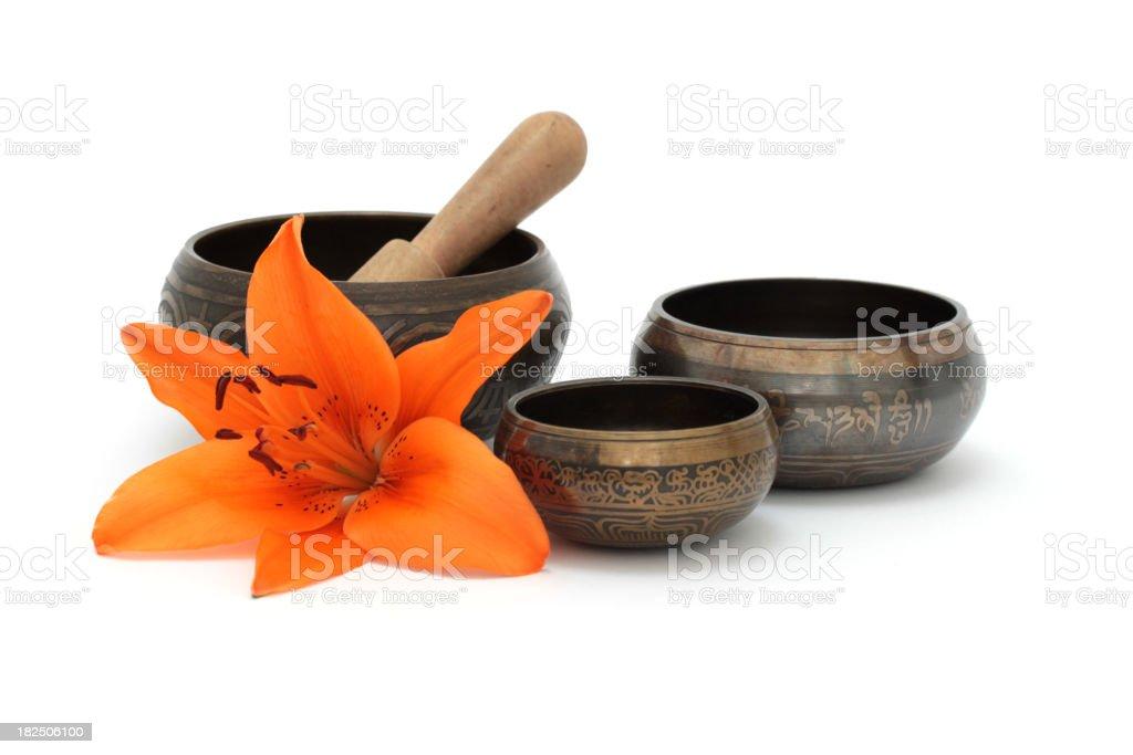 Tibetan singing bowls with flower stock photo