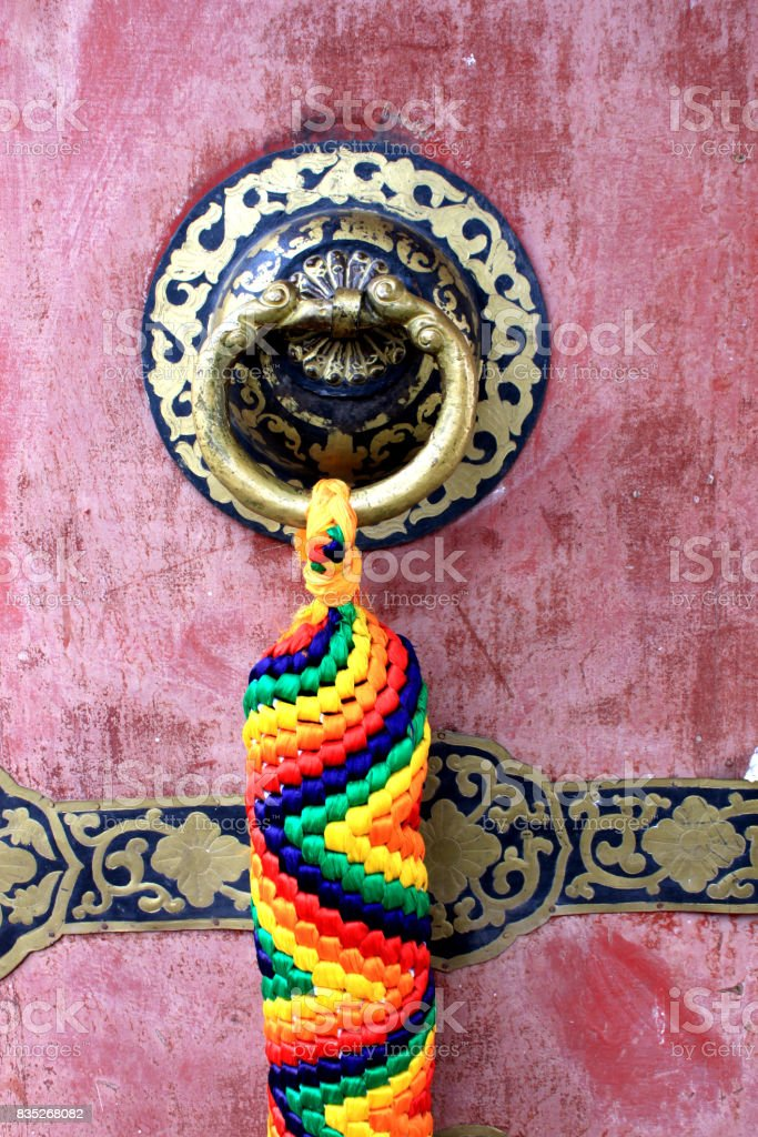 Tibetan style Chinese knot as a bolt and bell stock photo