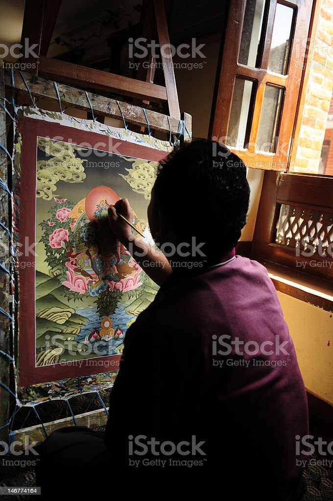 Tibetan Tangka painting at coloring stage stock photo