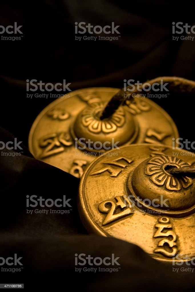 Tibetan Tingshas on silk royalty-free stock photo