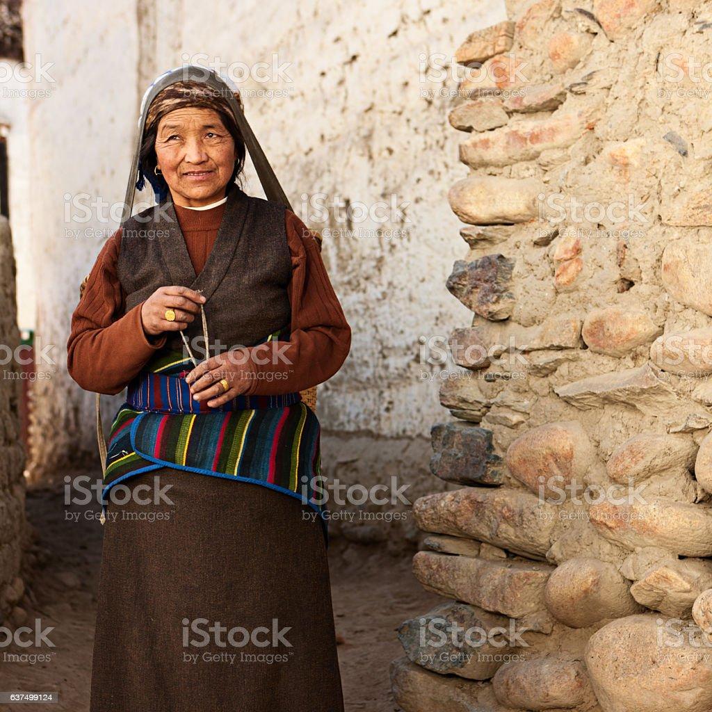 Tibetan woman carrying basket, Upper Mustang, Nepal stock photo