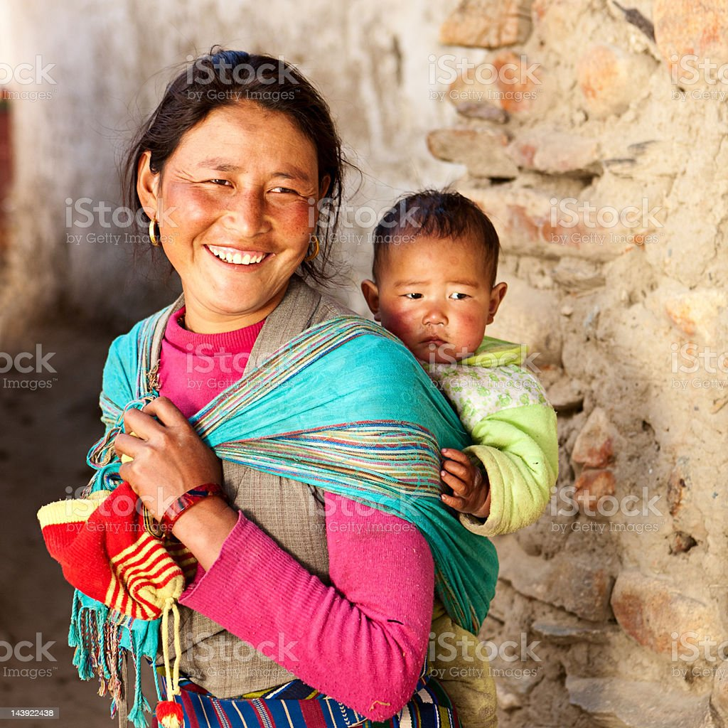 Tibetan woman carrying her baby stock photo