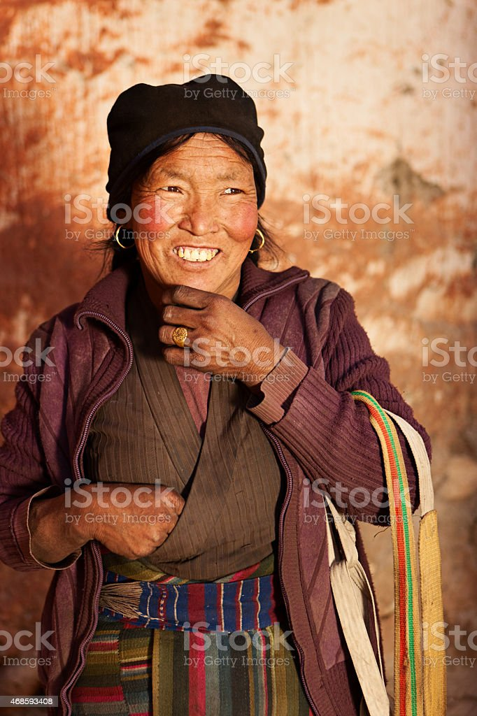 Tibetan woman in Lo Manthang, Mustang stock photo
