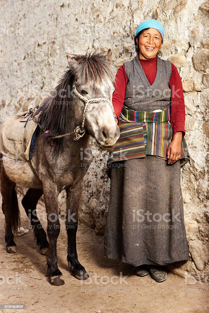 Tibetan woman leads her horse, Upper Mustang, Nepal stock photo