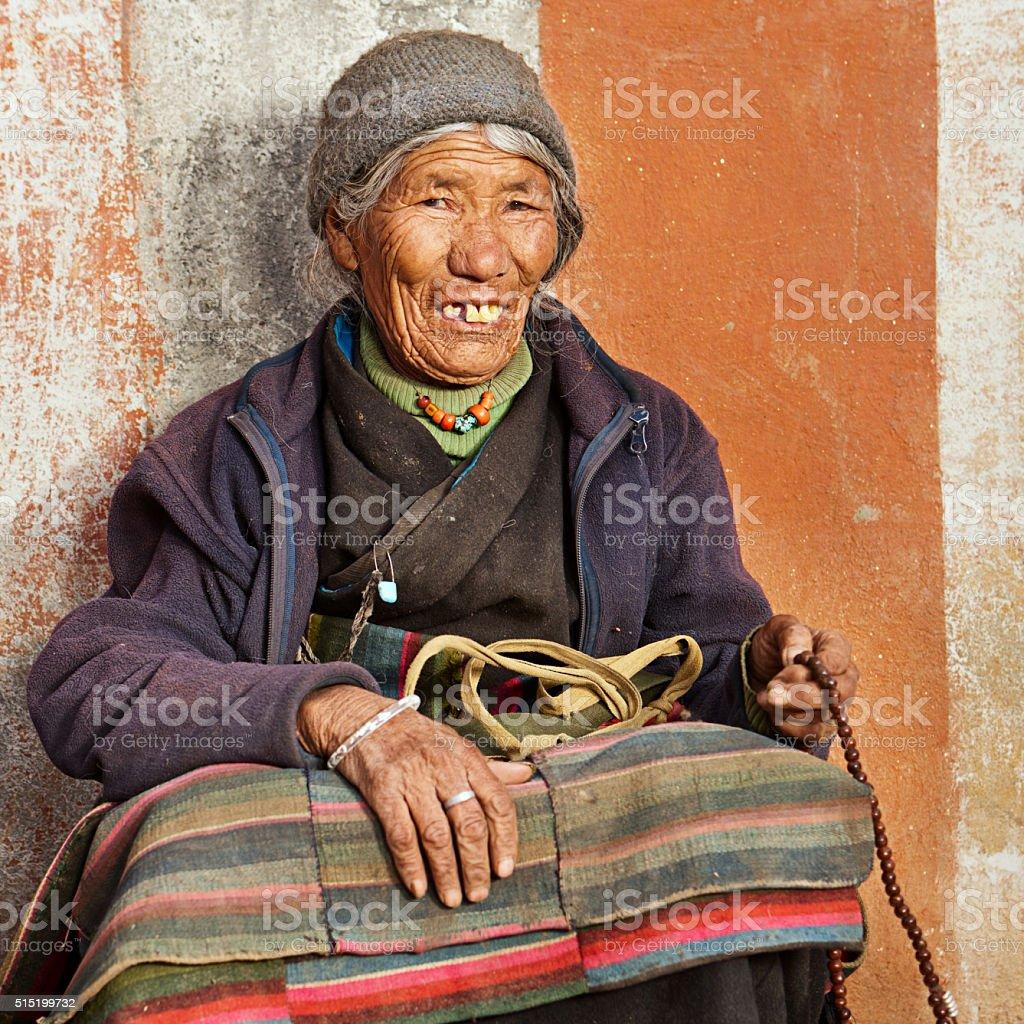 Tibetan woman praying in Lo Manthang, Upper Mustang stock photo