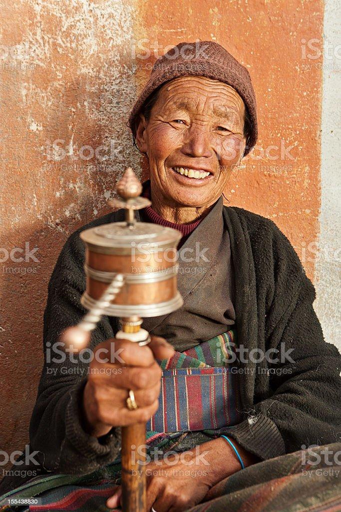 Tibetan woman praying, Mustang stock photo