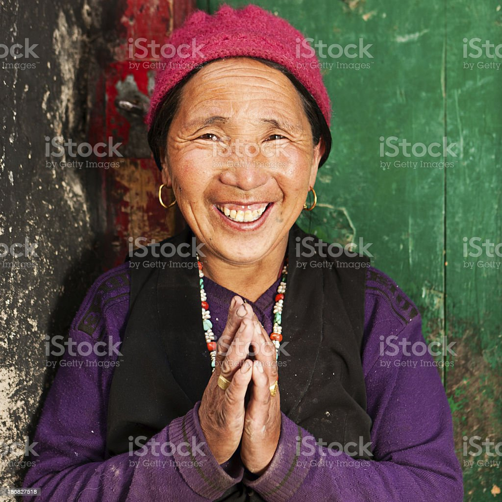Tibetan woman praying. stock photo