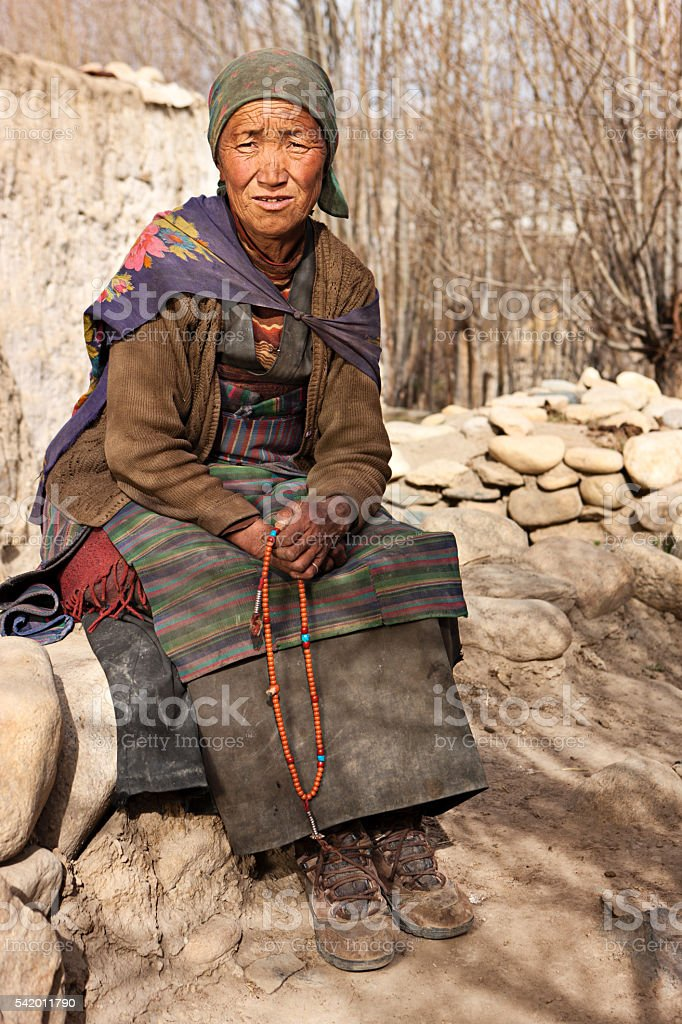 Tibetan woman praying with rosary, near Lo Manthang, Mustang, Nepal stock photo