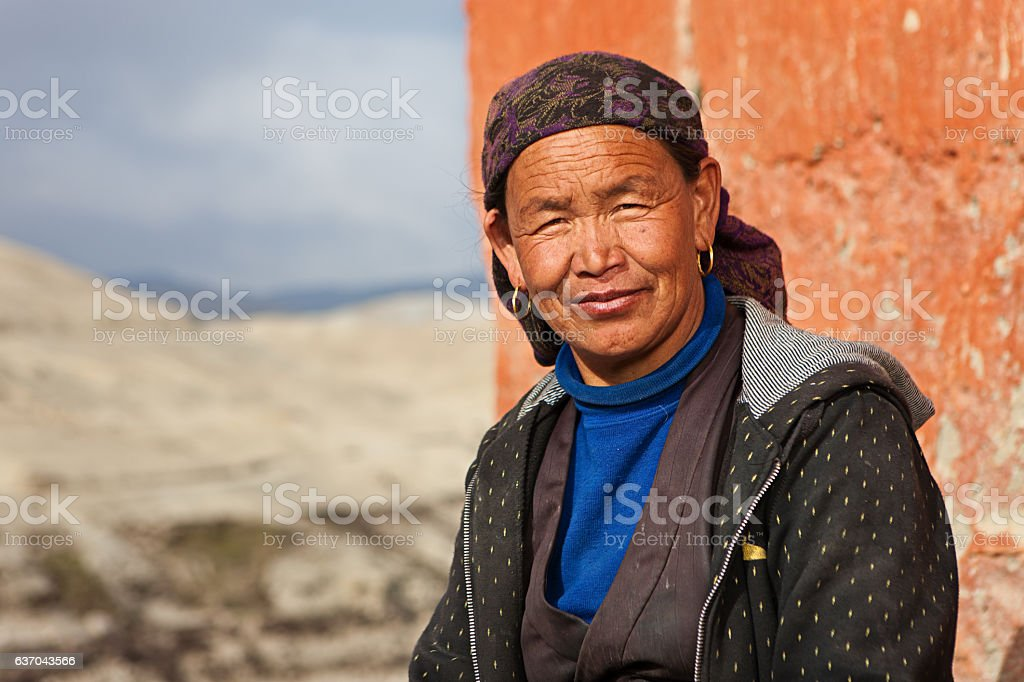 Tibetan woman resting in Lo Manthang, Upper Mustang stock photo