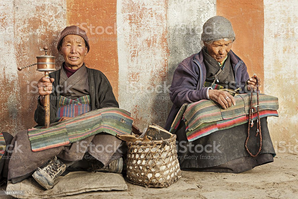 Tibetan women praying, Mustang stock photo