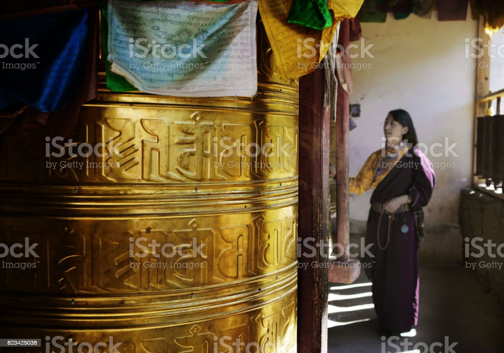 Tibetan young woman in the temple stock photo