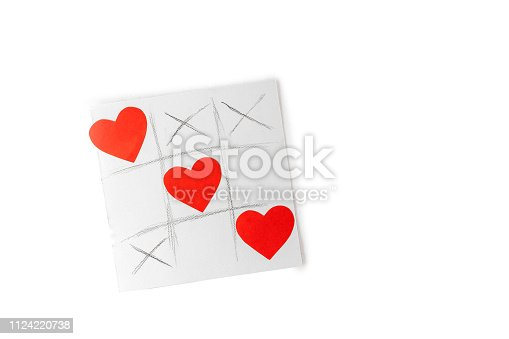 Valentine day concept, greetings card - tic tac toe drawn game with hearts isolated on white background