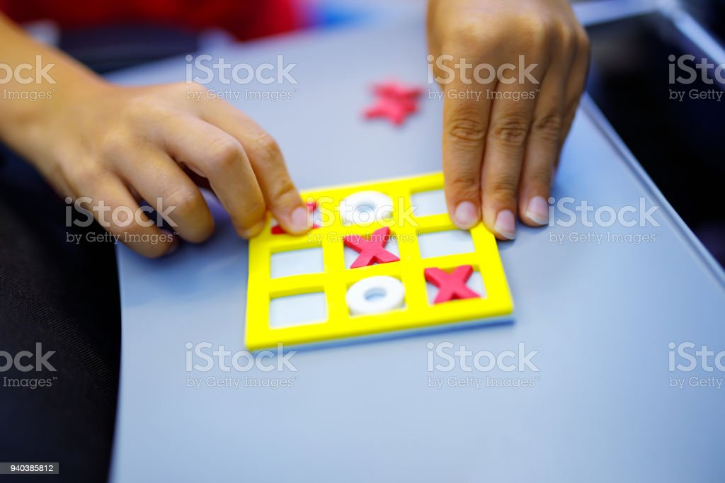 Tic tac toe game. Leisure activity for kids and adults. At home,...