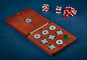 Tic Tac Toe in wooden box and dice, games and entertainment concept, shallow depth of field