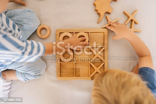 Photo of two little boys playing tic tac toe