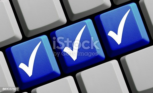 Blue computer keyboard with three white tick symbols